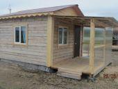 Деревянный домик с террасой 4-х местный